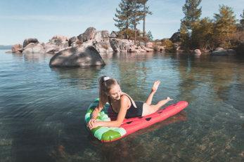 Girl floating in Lake Tahoe